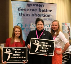 FFL interns Kara Sorenson, from Clarion University, (left) and Madeline Davin from Wheeling Jesuit (right), pose with FFL President Serrin Foster at the FFL booth at the first-ever Pro-Life Women's Conference in Dallas.